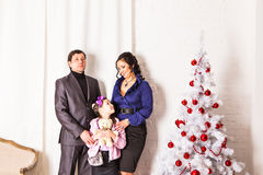 Family with gifts near Christmas tree Royalty Free Stock Image