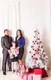 Family with gifts near Christmas tree Stock Image
