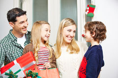 Family with gifts smiling at christmas eve Stock Photos