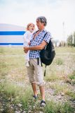 Family girl in the arms of his father outdoors. Stock Photo