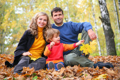 Family with girl in autumn park Royalty Free Stock Photo