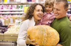 Family with girl buy pumpkin in supermarket Royalty Free Stock Photography