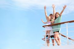 Family with girl with hands up, rests on yacht Royalty Free Stock Photography