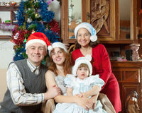 Family with girl posing for Christmas portrait Stock Photos