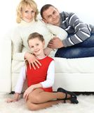 Family with girl sitting Stock Image