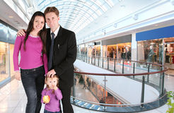 Family with girl in universal store Stock Photography