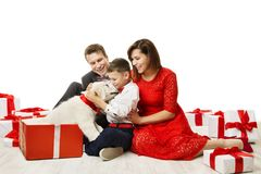 Family Gives Dog In Present Gift to Child, Father Mother Child Pet. Family Gives Dog In Present Gift to Son Child, Happy Kid Father Mother and Animal Pet stock photos