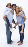 Family giving children piggyback ride Royalty Free Stock Photo