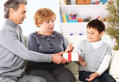 Family giving presents for Christmas Stock Photo