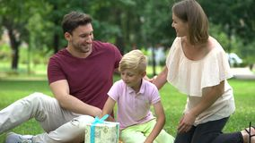 Family giving surprise gift to dad at fathers day or celebrating his birthday. Stock footage stock video footage