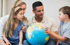 Family with globe in house Stock Photography