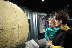 Family and globe of moon Stock Images