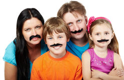 Family with glued artificial mustaches. Family of four with glued artificial mustaches Stock Images