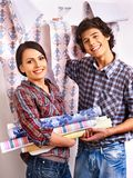 Family glues wallpaper at home. Stock Image