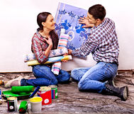 Family glues wallpaper at home. Stock Photography