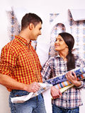 Family glues wallpaper at home. Stock Photos