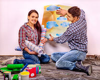 Family glues wallpaper at home Royalty Free Stock Photography