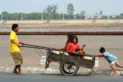 Family on the go. Father transporting his kids, Phnom Penh, Cambodia Royalty Free Stock Images