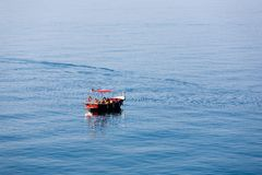 Family go fishing from a boat. On the high seas Stock Image