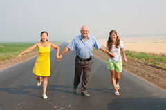 Family  go for a walk over a road Stock Photo