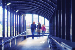 The family goes to the rhythmic arch pedestrian urban transition Stock Photo