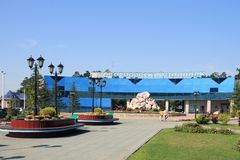 The family goes to the zoo in Novosibirsk. Novosibirsk, RUSSIA-AUGUST 01, 2011: the Square and the entrance to the city zoo on summer day royalty free stock photo