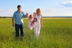 Family going across the field Stock Images