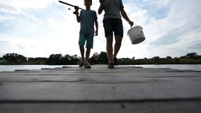 Family going fishing on the lake in summer stock footage