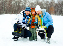 Family going ice skating stock photo