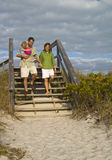 Family going to beach. A young happy family heading to the beach Royalty Free Stock Images