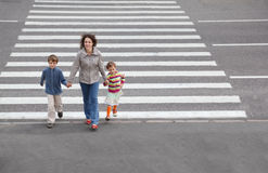 Family is going to cross road Stock Photo