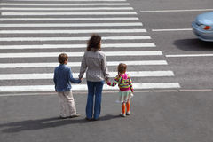 Family is going to cross road, behind Royalty Free Stock Images