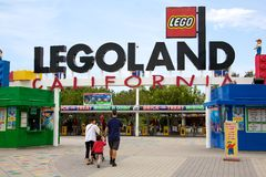 Family going to Legoland. A family walking into Legoland in Carlsbad California, USA Royalty Free Stock Photo