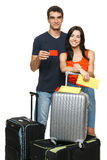 Family going to vacations. Young family standing with suitcases holding empty credit card, over white background. Travel credit card Stock Images