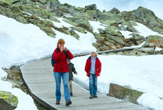 Family going on wooden flooring (Bettmerhorn, Switzerland). Stock Image