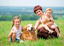 Family with a golden retriever dog Stock Photography