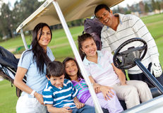 Family in a golf cart Stock Image