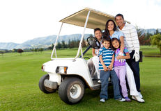 Family with a golf cart Stock Photo