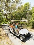 Family in golf cart. Caucasian family riding on golf cart on trail in North Carolina, USA Stock Photo