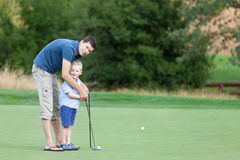 Family at golf course Royalty Free Stock Images