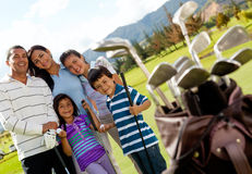Family of golf players Stock Photos