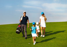 Family of golf players at the course Royalty Free Stock Images