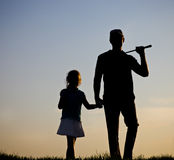 Family of a golfers at sunset Stock Photography