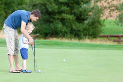 Family golfing Stock Photography