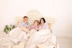 Family got sick, sneezing, and lie in bed at home Royalty Free Stock Photos