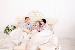 Family got sick, sneezing, and lie in bed at home Royalty Free Stock Image