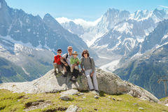 Family (grandfather, father and two boys) rest on summer mountain Royalty Free Stock Images