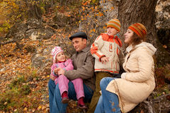 Family with grandfather in forest in autumn Stock Photography