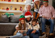 Family with grandma and grandpa enjoy in Christmas eve. Family with grandma and grandpa enjoy together in Christmas eve Stock Photos