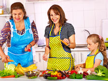 Family with grandmother and child at kitchen. Stock Photography